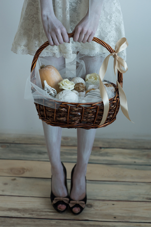 Halloween witch pick up basket with treats Stock Photo