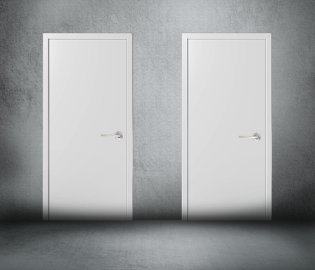Two white closed doors on gray background
