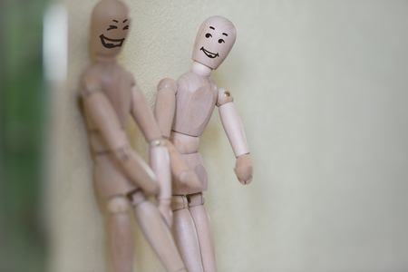 Wooden people standing at home and chatting. People relationship concept. Drawn faces Archivio Fotografico