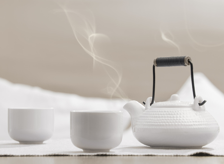 Teapot and cups on table at comfortable relaxation lounge