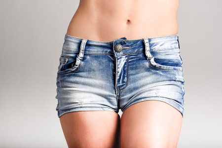Beautiful woman body in denim jeans shorts on white background Banque d'images - 101754320