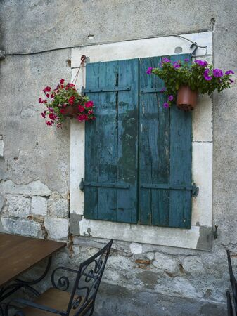 Potted plants hanging on window at restaurant, Kotor, Bay of Kotor, Montenegro, Stock Photo