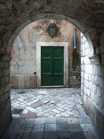 Closed door seen through arch, Kotor, Bay of Kotor, Montenegro