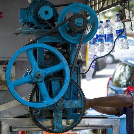 Machinery at a sugar cane juice stall, Mumbai, Maharashtra, India