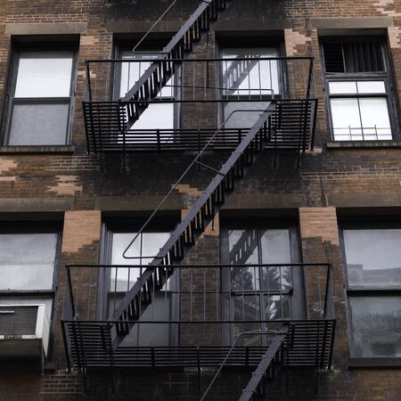 Low angle view of fire escape on apartment building, Lower Manhattan, New York City, New York State, USA 스톡 콘텐츠