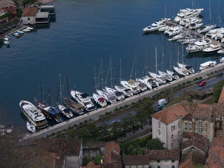 Aerial view of boats moored at port seen from the way to Kotor Fortress, Kotor, Bay of Kotor, Montenegro