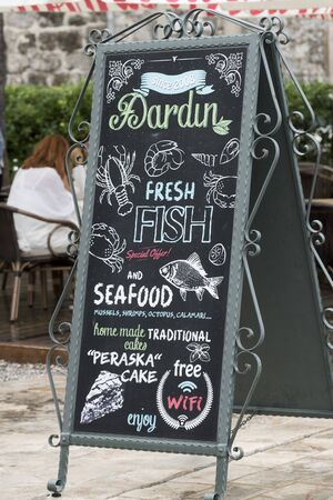 Close-up of restaurant signboard, Perast, Bay of Kotor, Montenegro