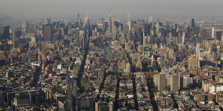 Aerial view of cityscape with Empire State Building in the background, Manhattan, New York City, New York State, USA