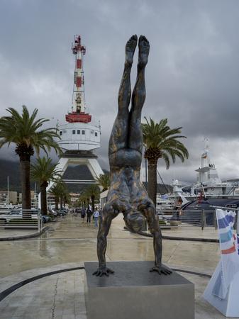 Statue of a man doing handstand, Porto Montenegro, Bay of Kotor, Montenegro