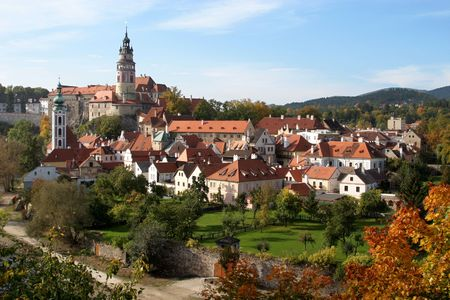 Fall view of a famous city of Cesky Krumlov, situated in South Bohemia, Czech Republic and its castle - UNESCO heritage - built between 14th and 19th centuries.  Stock Photo