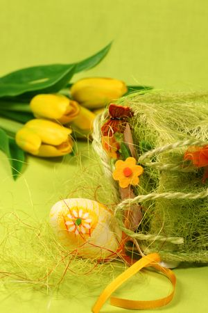 Easter egg with flower, decoration and tulips. Shallow DOF photo
