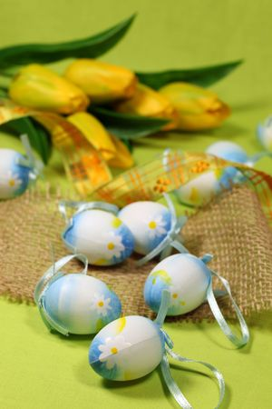 Blue Easter eggs and yellow tulips photo
