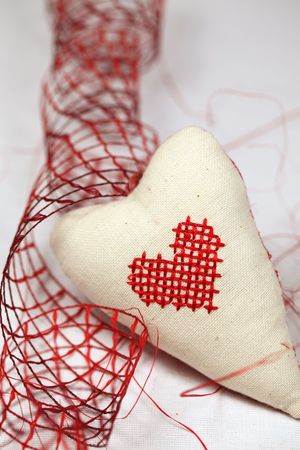 Fabric heart with embroidered little heart and red ribbon photo