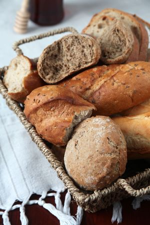 Basket with different kinds of fresh bread photo