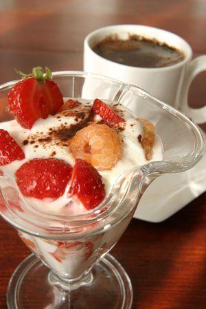 Yogurt dessert with fruits and coffee photo