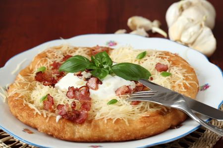 Langos, traditional Hungarian pancake with cheese, bacon, and garlic Stock Photo - 6239157