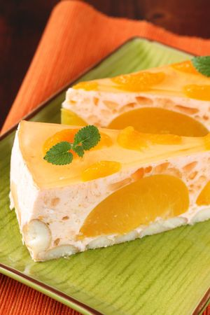 Peach mousse with tangerines and jelly photo