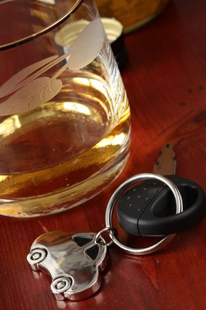 Car key and a glass with Whiskey photo