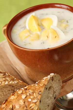 Dill soup with egg and potatoes photo