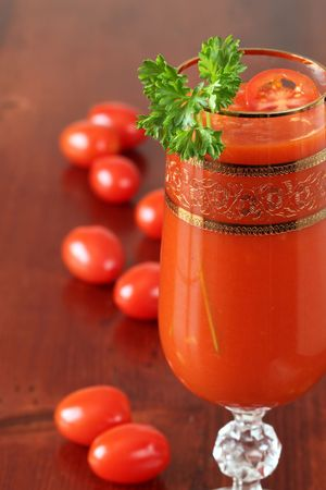 Tomato juice or Bloody Marywith slice of cherry tomato and parsley photo