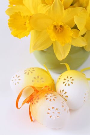 Flowery Easter eggs and yellow daffodils photo