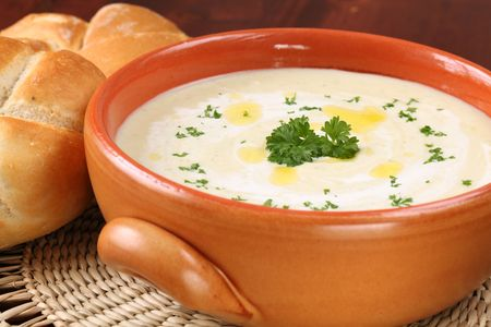 Vegetable cream soup made of carrot, potato, broccoli, green beans, parsley and cream Stock Photo