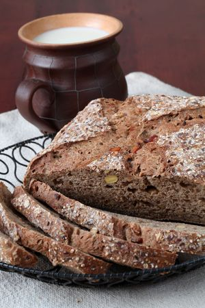 breadloaf: Loaf of wholemeal bread with slices and milk