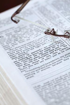 Open Bible and glasses. Focus on the text in Mark 16:6 - He has risen! Stock Photo - 6660291