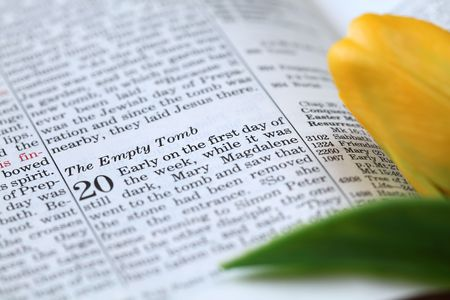 graves: Open Bible with focus on the text in John 20 about Jesus resurrection. Shallow DOF Stock Photo
