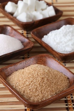 Sugar in wooden bowls Stock Photo - 6660339