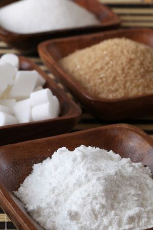 Sugar in wooden bowls Stock Photo