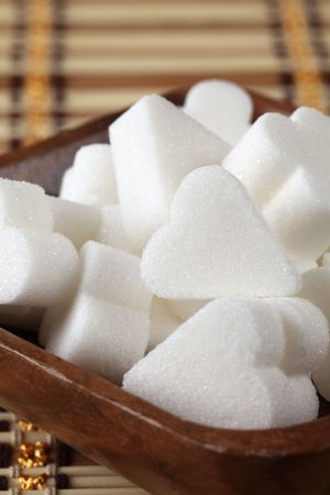 Bridge shape sugar cubes in a wooden bowl photo