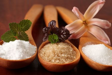 Sugar in wooden spoons Stock Photo