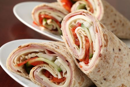 Wholemeal tortillas with ham, cheese, tomatoes, cucumber and cabbage