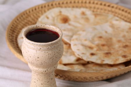 Wine and pita bread in a basket