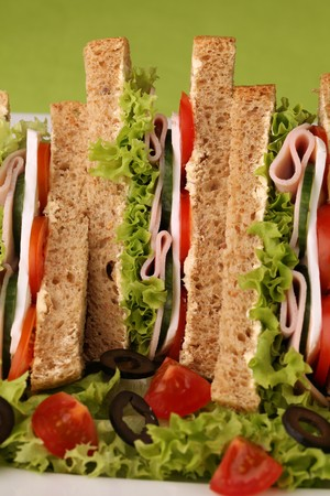 Healthy sandwiches with ham, camembert and vegetables photo