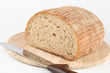 breadloaf: Loaf of fresh bread on cutting board Stock Photo