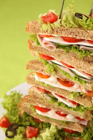 Healthy sandwiches with ham, camembert, tomatoes, cucumber, lettuce and black olives photo
