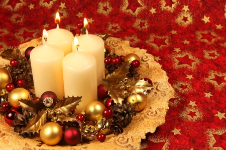 Christmas decoration with four candles on red Christmas background photo