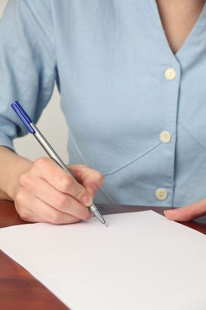 Female hand signing an empty document. Copy space. Stock Photo - 7076546