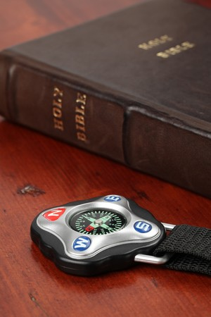 Compass and the Holy Bible in background photo