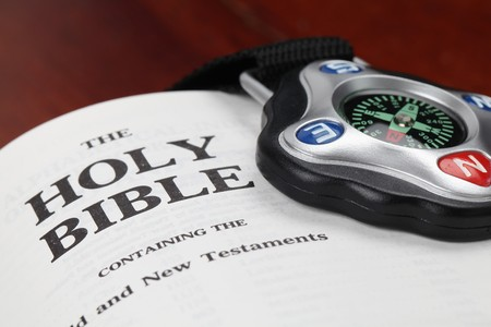 Compass and open Holy Bible photo