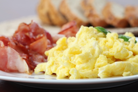 breakfast eggs: Scrambled eggs and bacon Stock Photo