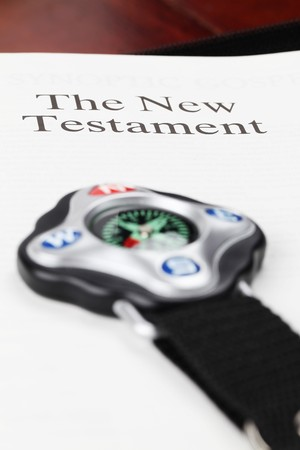 Compass and open Bible on the New Testament page photo