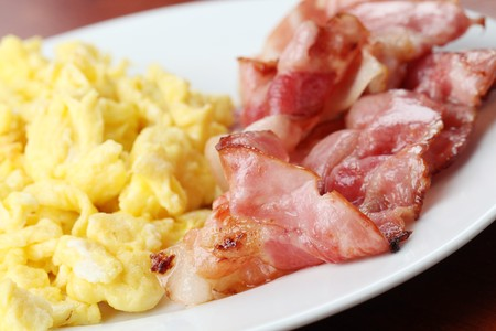 Scrambled eggs and bacon photo