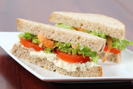 Vegetarian sandwiches with egg spread, lettuce, tomatoes and carrots photo