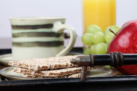 Healthy breakfast consisting of fresh fruits, crackers, orange juice and tea or coffee photo