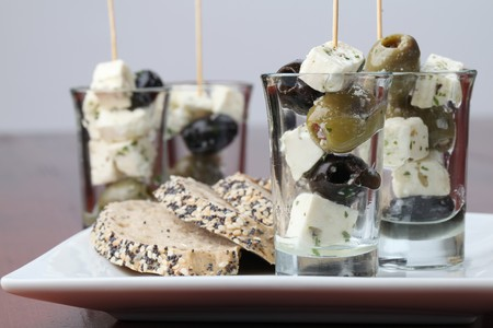Greek appetizers with black and green olives and feta cheese photo