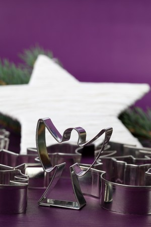 Angel shaped cookie cutter and other cutters on Christmas background Stock Photo - 7387124