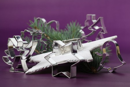 Various shaped cookie cutters on Christmas background Stock Photo - 7387121